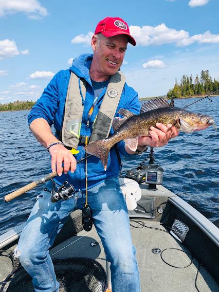 Gord Ellis with walleye on Lund boat